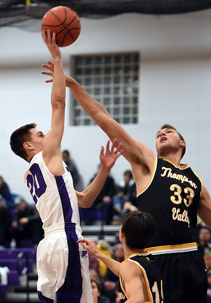 Mountain View's #20Brexton Butcher goes up for a shot as Thompson Valley's #33 Jared Kasprzak tries to block during their game Friday, Jan. 6, 2017, at Mountain View High School in Loveland. (Photo by Jenny Sparks/Loveland Reporter-Herald)
