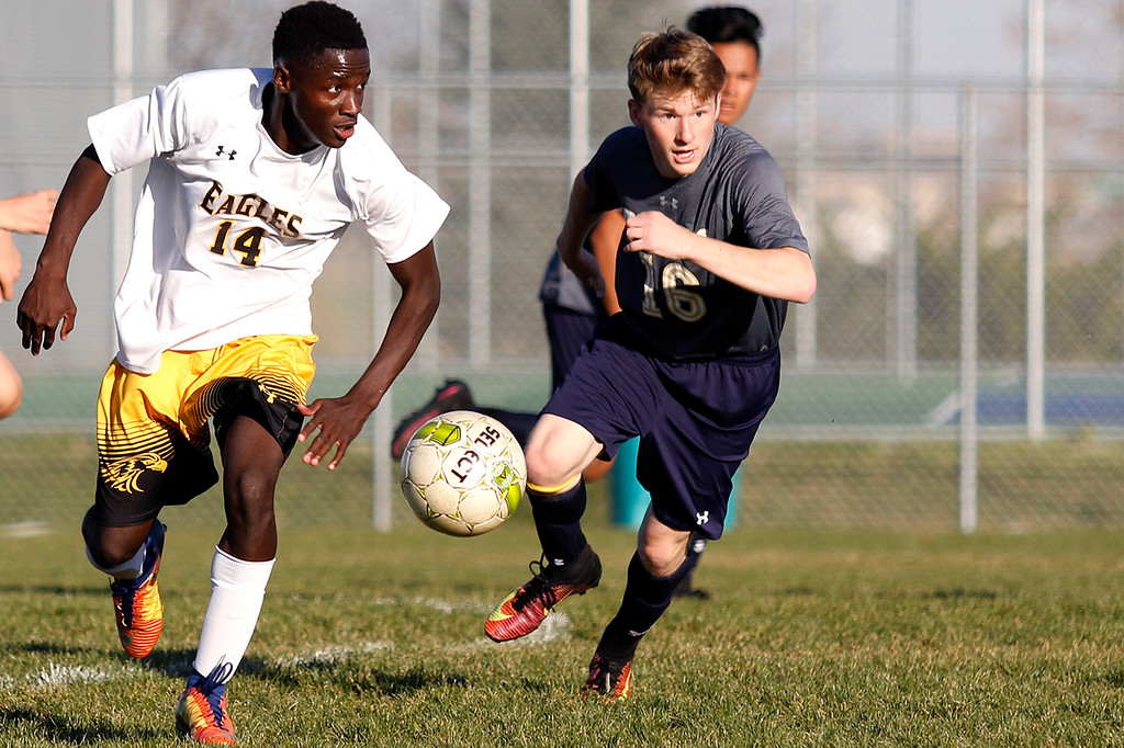 . Thompson Valley�s Junio Lang (14) runs the ball toward the goal defending it against Palmer Ridge�s Jeremy Douglas (16) at Mountain Valley High School in Loveland on Wednesday, Oct. 18, 2017. (Photo by Lauren Cordova/Loveland Reporter-Herald)