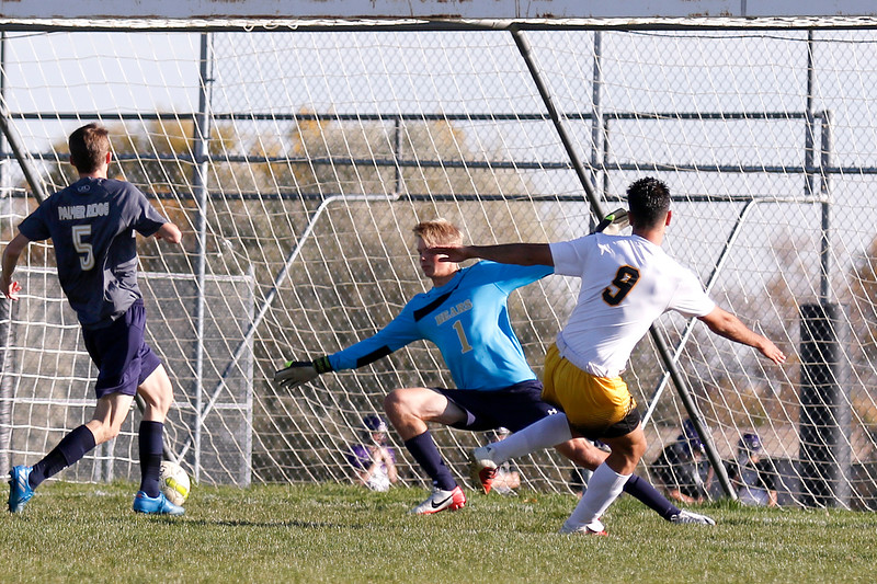 Thompson Valley's Pablo Gomez-Cervantes (9) scores a goal against Palmer Ridge as keeper Nathaniel Kugler (1) and Trent Douglas (5) fail to block it at Mountain Valley High School in Loveland on Wednesday, Oct. 18, 2017. (Photo by Lauren Cordova/Loveland Reporter-Herald)