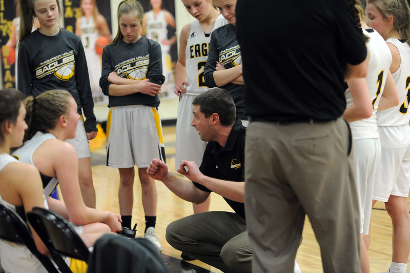 Thompson Valley coach Paul Arrington instructs his team between quarters against Regis Groff. (Colin Barnard/Loveland Reporter-Herald)