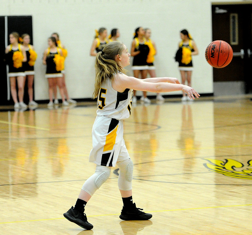 . Amelia Solt dishes a pass to a teammate during Thompson Valley\'s victory over Regis Groff. (Colin Barnard/Loveland Reporter-Herald)