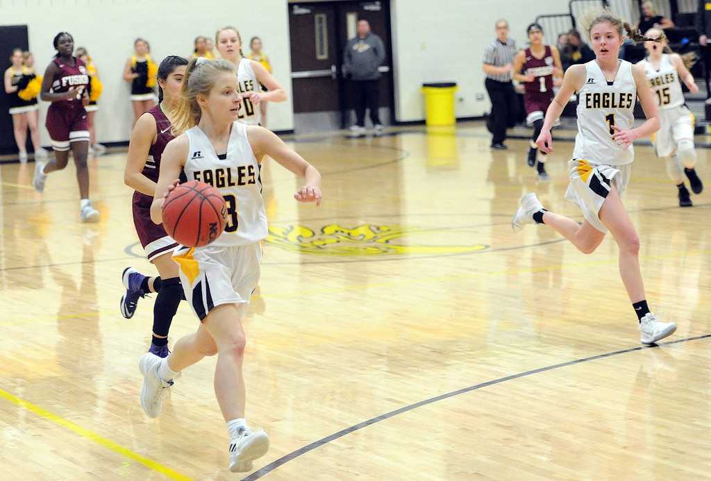 . Kyla Schuetz, left, leads a fastbreak with Emily Black in the first quarter against Regis Groff. (Colin Barnard/Loveland Reporter-Herald)