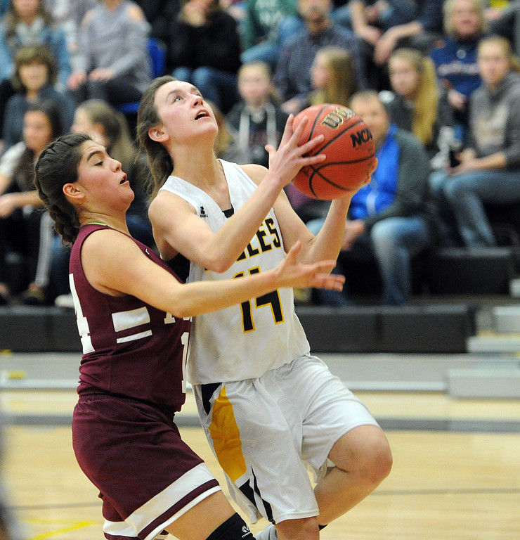. Kylie Bowen beats her defender to the basket in the second quarter of the Eagles\' victory over Regis Groff. (Colin Barnard/Loveland Reporter-Herald)