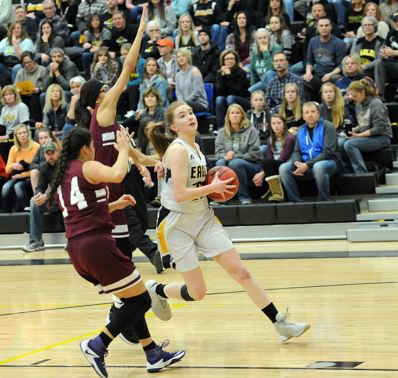 . Sydney Durtsche beats two Regis Groff defenders to the rim on a breakway during the Eagles\' win on Tuesday night. Durtsche led the team with 15 points.