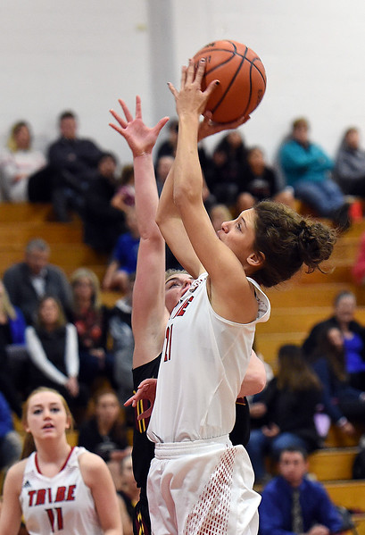 Loveland's (21) Kennedy Burch goes up for a shot past Rocky Mountain's (5) Kiley Towne during their game on Friday, Jan. 5, 2018, at Loveland High School in Loveland.  (Photo by Jenny Sparks/Loveland Reporter-Herald)