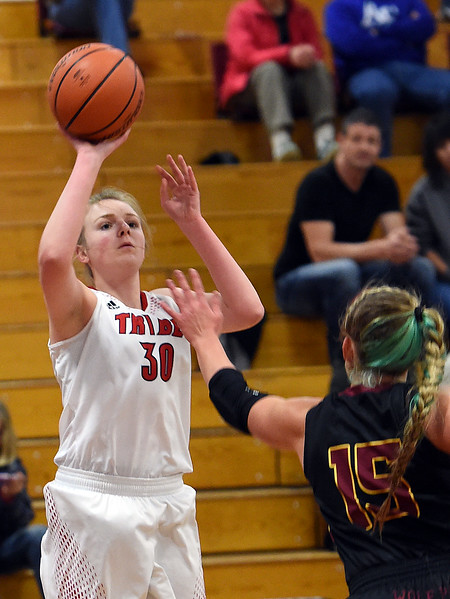Loveland's (30) Brynne Rydbom goes up for a shot past Rocky Mountain's (15) Gabby McDonald during their game on Friday, Jan. 5, 2018, at Loveland High School in Loveland.  (Photo by Jenny Sparks/Loveland Reporter-Herald)