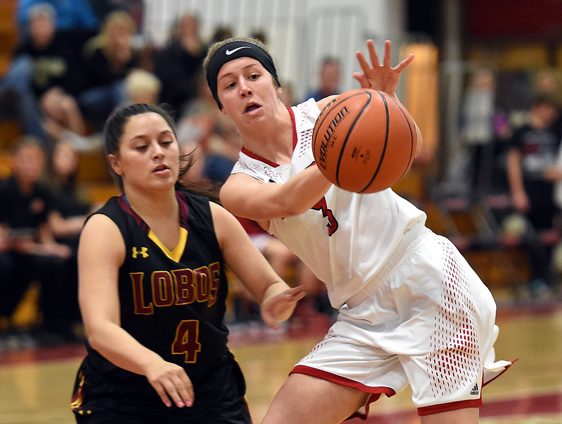 Loveland's (3) Shelby Buhler passes the ball during their game against Rocky Mountain High School on Friday, Jan. 5, 2018, at Loveland High School in Loveland.  (Photo by Jenny Sparks/Loveland Reporter-Herald)