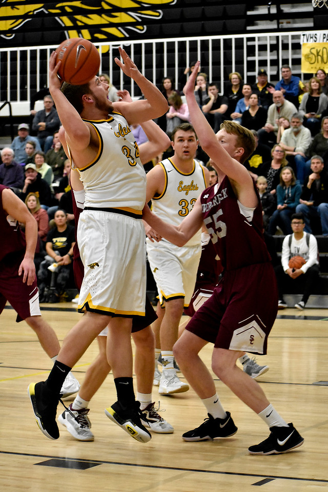 Thompson Valley's (34) Joey Shaffer goes for a jump shot over Silver Creek's (55) Erik Grossaint during their game on Tuesday, Feb. 6, 2018 at Thompson Valley High School in Loveland. Photo by Thieng Mai/Loveland Reporter-Herald.