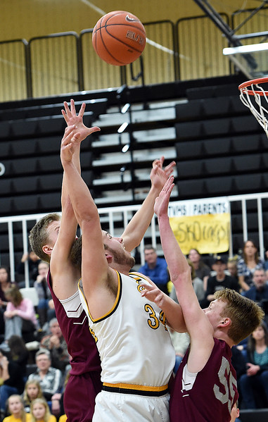 Thompson Valley's (34) Joey Shaffer goes up for a shot past Silver Creek's (2) Trent Dykema and (55) Erik Grossaint during their game Tuesday, Feb. 6, 2018, at Thompson Valley in Loveland. (Photo by Jenny Sparks/Loveland Reporter-Herald)