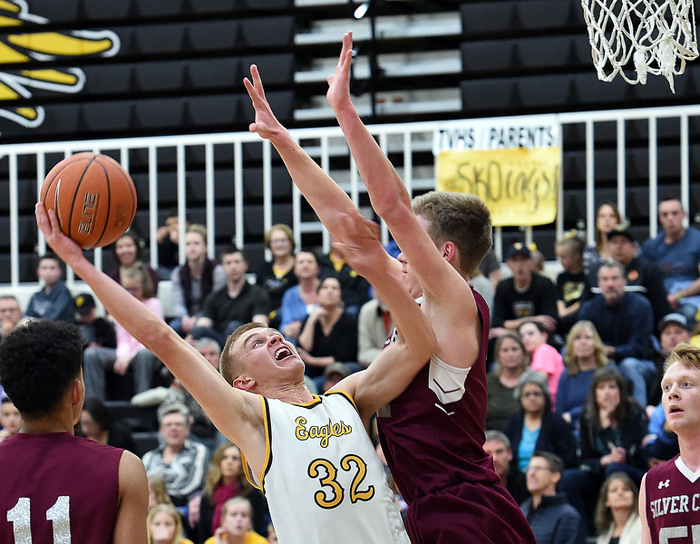 Thompson Valley's (32) Darren Edwards gets fouled by Silver Creek's (3) Andrew Duquette as he goes up for a shot during their game Tuesday, Feb. 6, 2018, at Thompson Valley in Loveland. (Photo by Jenny Sparks/Loveland Reporter-Herald)