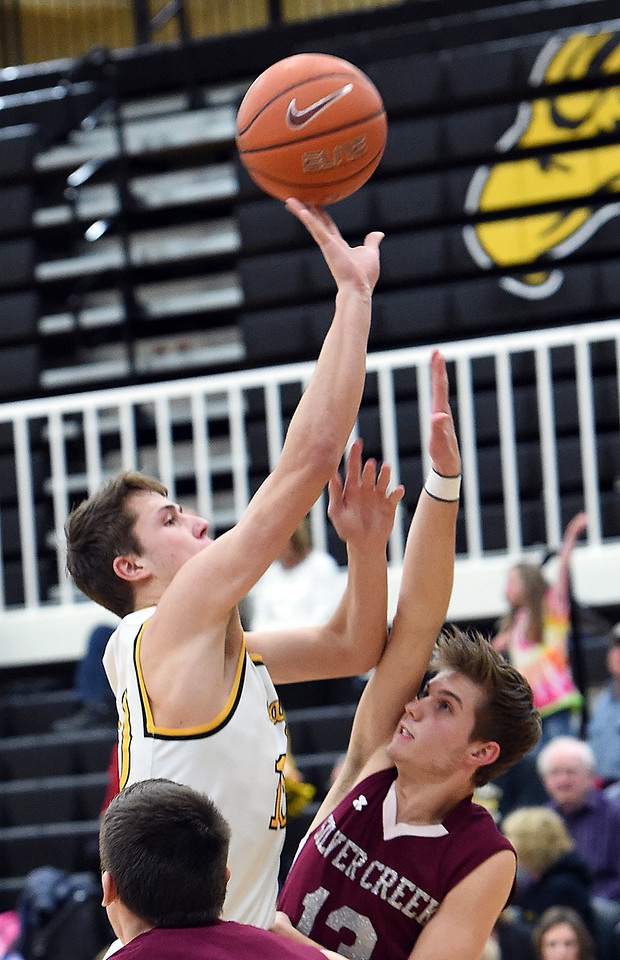 Thompson Valley's (10) Justin Wiersema goes up for a shot past Silver Creek's (3) Andrew Duquette during their game Tuesday, Feb. 6, 2018, at Thompson Valley in Loveland. (Photo by Jenny Sparks/Loveland Reporter-Herald)