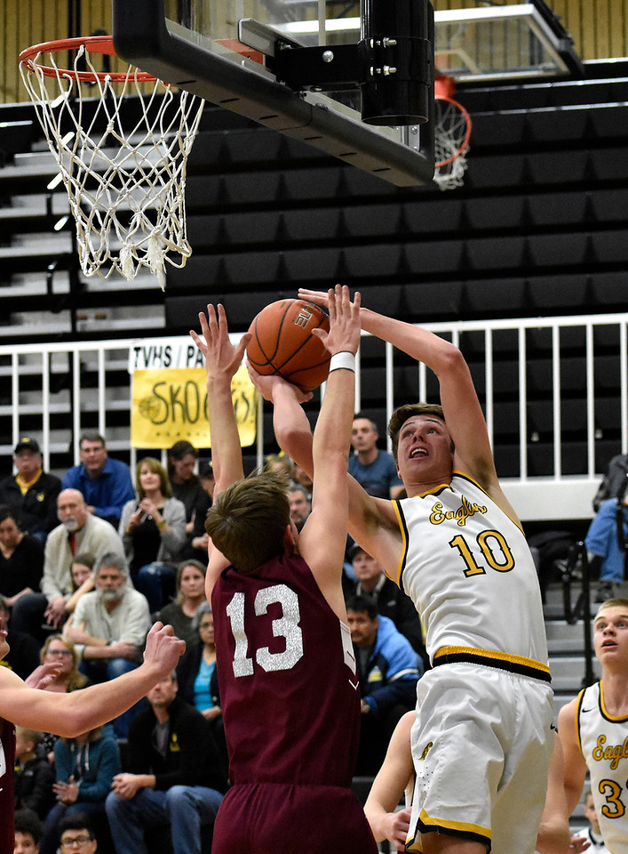 Thompson Valley's (10) Justin Wiersema tshoot at an angle over Silver Creek's (13) Christian Warner's block during their game on Tuesday, Feb. 6, 2018 at Thompson Valley High School in Loveland. Photo by Thieng Mai/Loveland Reporter-Herald.