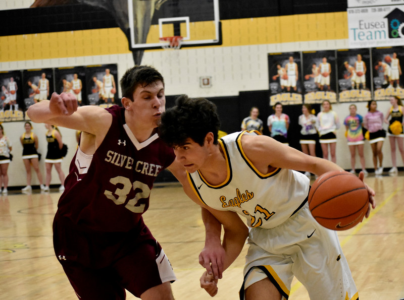 Thompson Valley's (21) Adrian Juarez quickly gets the ball past Silver Creek's (32) Trevor Riters during their game on Tuesday, Feb. 6, 2018 at Thompson Valley High School in Loveland. Photo by Thieng Mai/Loveland Reporter-Herald.