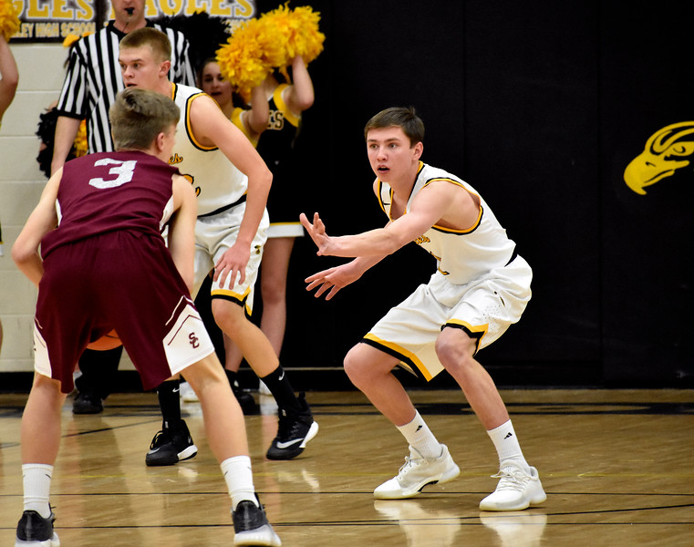 Thompson Valley's (1) Tony Klagge keeps up kis block against Silver Creek's (3) Andrew Duquette during their game on Tuesday, Feb. 6, 2018 at Thompson Valley High School in Loveland. Photo by Thieng Mai/Loveland Reporter-Herald.