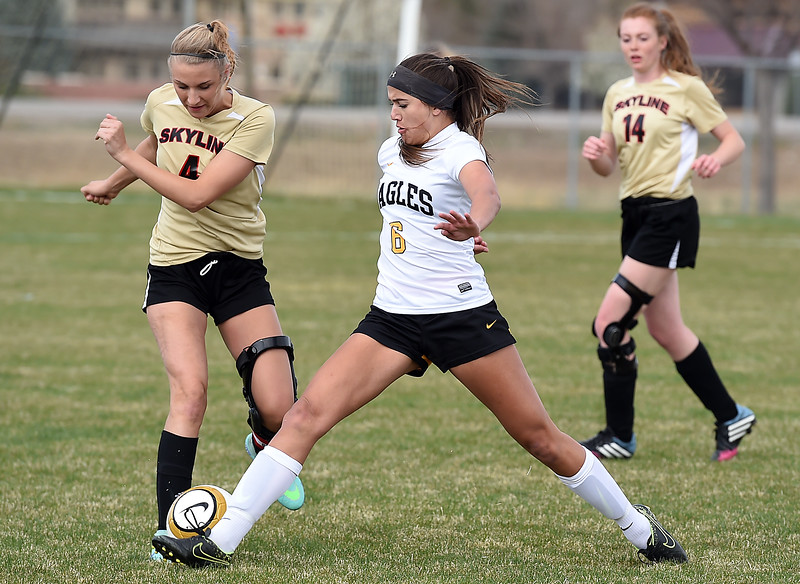 Thompson Valley's #6 Kaili Campbell and Skyline's #4 Rachel Billeter battle for the ball Monday, April 3, 2017, during their game at Mountain View High School in Loveland.  (Photo by Jenny Sparks/Loveland Reporter-Herald)