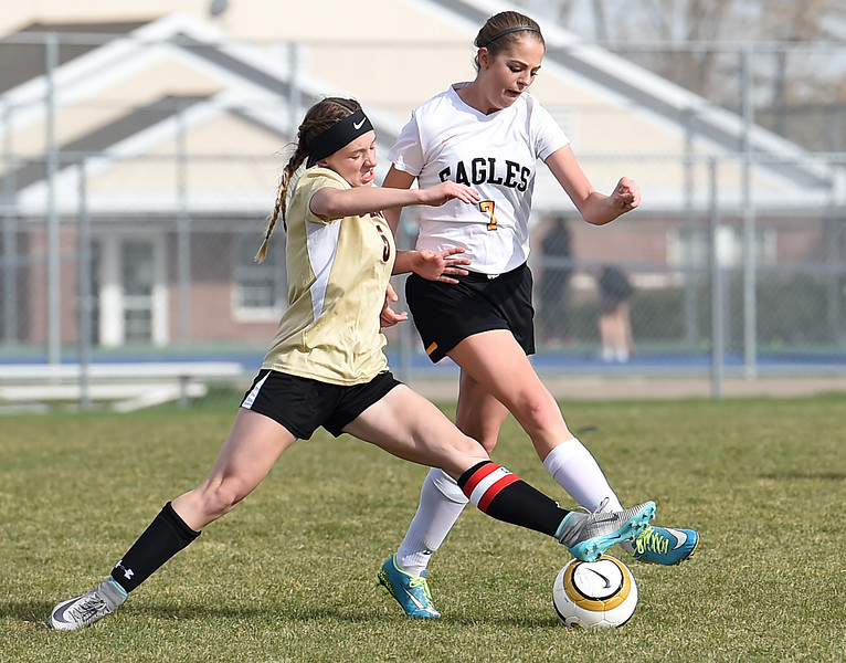 Thompson Valley's #7 Emily Dawes and Skyline's #5 Kalen Niedling battle for the ball Monday, April 3, 2017, during their game at Mountain View High School in Loveland.  (Photo by Jenny Sparks/Loveland Reporter-Herald)