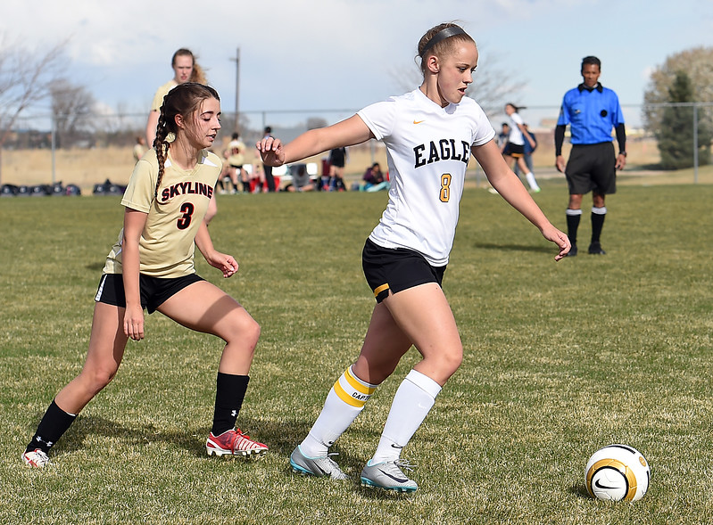 Thompson Valley's #8 Kylee Morris gets control of the ball Monday, April 3, 2017, during their game against Skyline High School at Mountain View High School in Loveland.  (Photo by Jenny Sparks/Loveland Reporter-Herald)