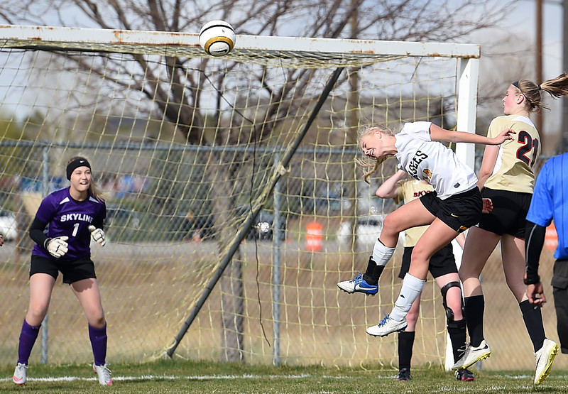 Thompson Valley's #14 Novi Briggs tries to hit a header into the net Monday, April 3, 2017, during their game against Skyline High School at Mountain View High School in Loveland.  (Photo by Jenny Sparks/Loveland Reporter-Herald)