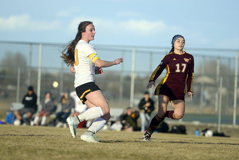 Windsor's Alyssa Lobato can only look on in dismay as Thompson Valley's Kahrena Thompson watches her shot find the back of the net Friday at the MVHS field. Windsor won 6-1. (Mike Brohard/Reporter-Herald)