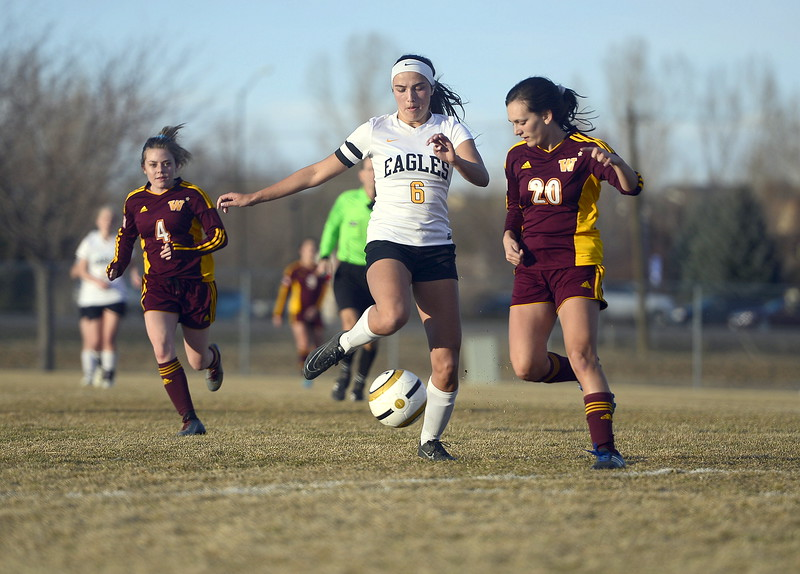 Thompson Valley's Kaili Campbell moves the ball down field against the defense of Windsor's Rachel Zimmerman during Friday's match at the MVHS field. Campbell assisted on the Eagles' lone goal in their 6-1 defeat. (Mike Brohard/Reporter-Herald)