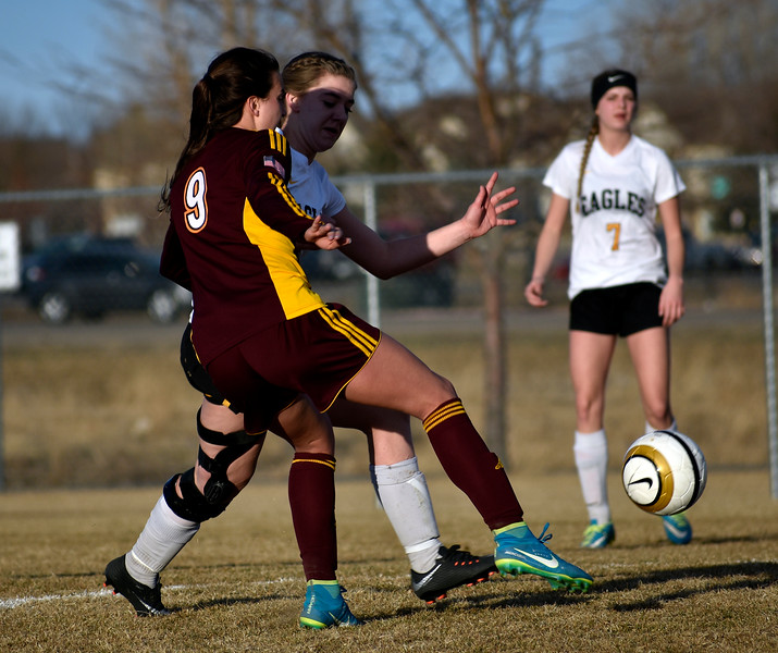 Thompson Valley's (4) Alayna McCrimmon defending against Windsor's (9) Chaynee Kingsbury during their game on Friday, March 9, 2018 at Mountain View High School in Loveland. Photo by Thieng Mai/Loveland Reporter-Herald.