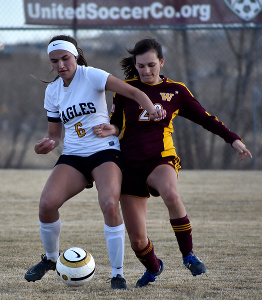 Thompson Valley's (6) Kaili Campbell manages to steal the ball from Windsor's (20) Rachel Zimmerman during their game on Friday, March 9, 2018 at Mountain View High School. Photo by Thieng Mai/Loveland Reporter-Herald.