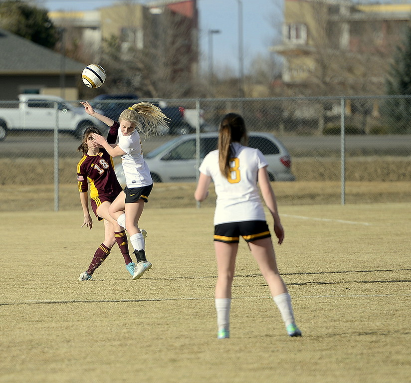 Thompson Valley's Novi Briggs turns away as Windsor's Julia Broghammer fires a long pass downfield during their match Friday at the MVHS field. (Mike Brohard/Reporter-Herald)