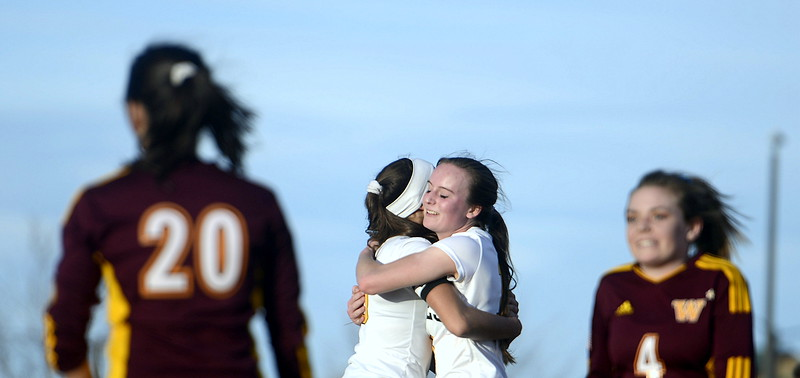 Thompson Valley's Kahrena Thompson (right) and Kaili Campbell hug after Thompson scored a goal off a Campbell assist in Friday's match with Windsor at the MVHS field. (Mike Brohard/Reporter-Herald)