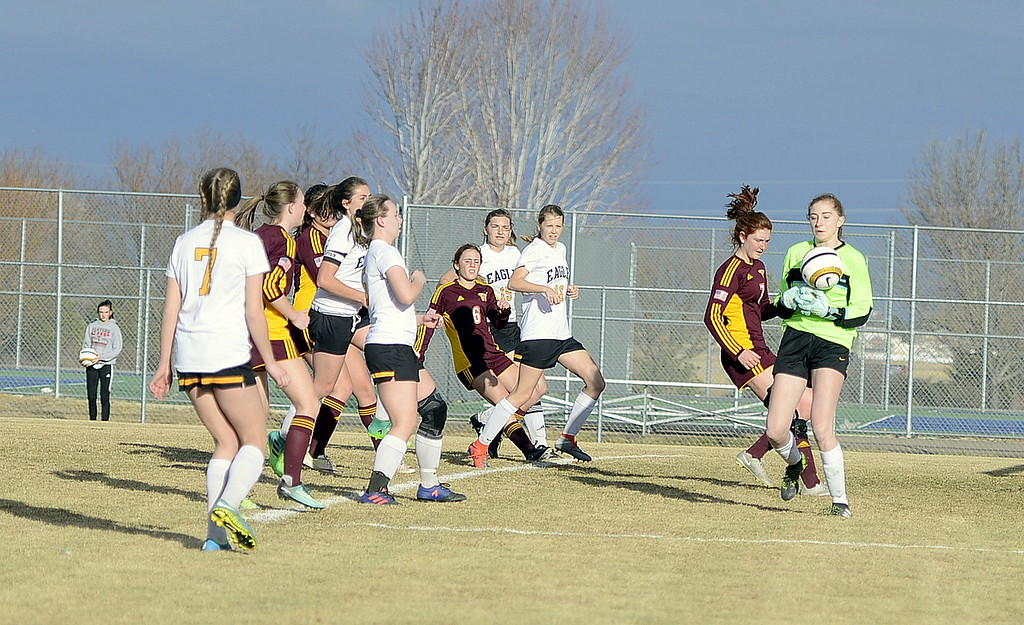 . Thompson Valley goalie Sydnee Durtsche steps up to make a save during Friday\'s match with Windsor at the MVHS field. The Wizards posted a 6-1 victory. (Mike Brohard/Reporter-Herald)