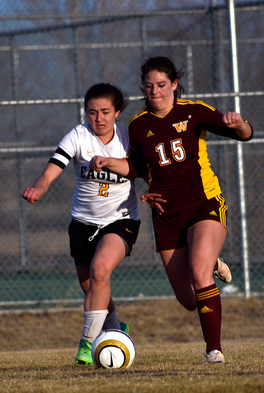 . Thompson Valley\'s (2) Anna Mihaly and Windsor\'s (15) Alex Ramirez both attempt to get possession of the ball during their game on Friday, March 9, 2018 at Mountain View High School. Photo by Thieng Mai/Loveland Reporter-Herald.