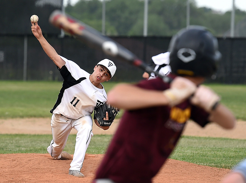Thompson Valley's Adrian Nava (11) pitches the ball Thursday, June 15, 2017, during their game against Windsor at Constantz Field Loveland.   (Photo by Jenny Sparks/Loveland Reporter-Herald)