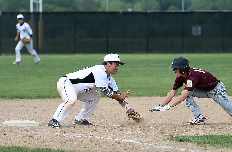Thompson Valley's Tyler Ewy-Self (10) tries to tag a Windsor player Thursday, June 15, 2017, during their game at Constantz Field Loveland.   (Photo by Jenny Sparks/Loveland Reporter-Herald)