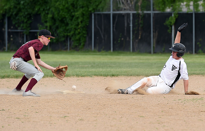 Thompson Valley's Trenton Riehl (22) slides in to second base Thursday, June 15, 2017, during their game against Windsor at Constantz Field Loveland.   (Photo by Jenny Sparks/Loveland Reporter-Herald)