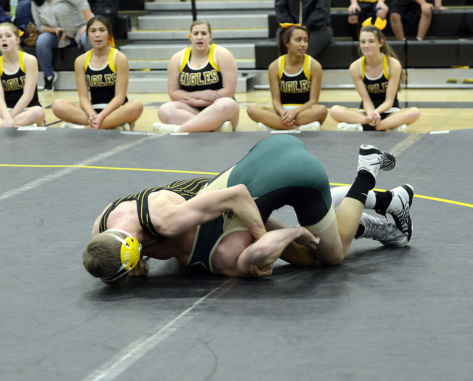 Thompson Valley's Hunter Williams folds Bear Creek's Mason Hogan on his way to a fall in 1:11 at 160 pounds during Wednesday's dual with Bear Creek at the TVHS gym.