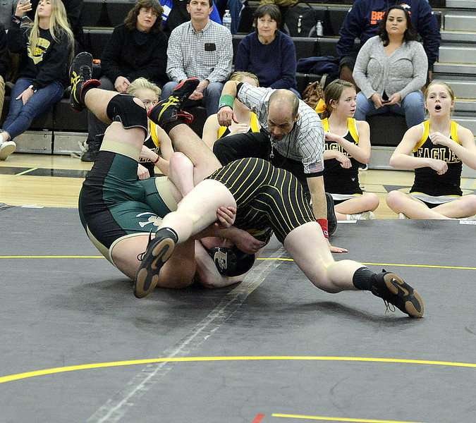 Thompson Valley's Chris Ringus hits a cradle against Bear Creek's Josh Lind at 220 pounds during Wednesday's dual  at the TVHS gym. Ringus' pin came in a program-record tying 7 seconds.