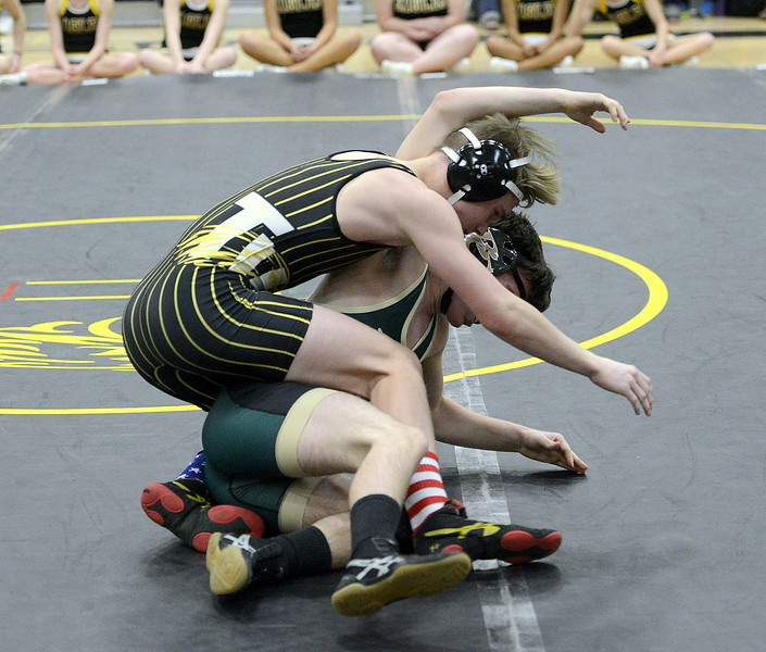 Thompson Valley's Trent Suppus hits a takedown against Kobe McDade at 138 pounds during Wednesday's dual with Bear Creek at the TVHS gym. Suppus won by fall in 2:41.