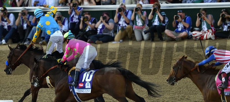 Victor Espinoza celebrating aboard American Pharoah after winning the 141st Kentucky Derby