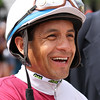 Triple Crown winning jockey VICTOR ESPINOZA greets the adoring crowd with smiles before the American Pharoah parade at Santa Anita 06.27.15.