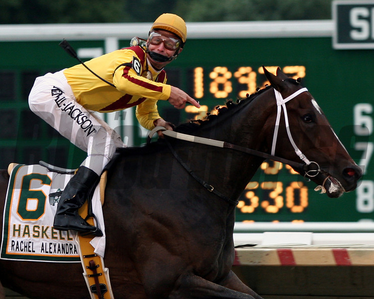 Calvin Borel pointing at Rachel Alexandra and looking at the crowd coming under the wire to win the 42nd running of the Haskell Invitational at Monmouth Park on August 2, 2009.<br /> Chad Harmon photo