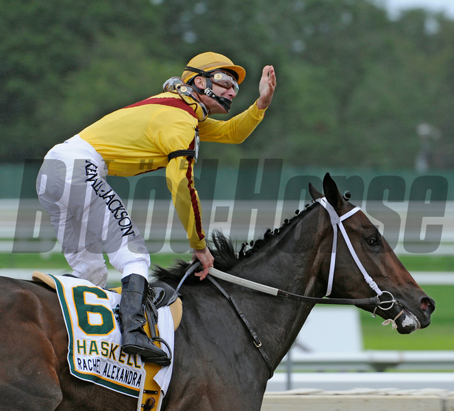 Jockey Calvin Borel aboard Rachel Alexandra throws kisses to the crowd after winning the 42nd running of The Haskel Invitational at Monmouth Park in Oceanport, New Jersey August 2, 2009.