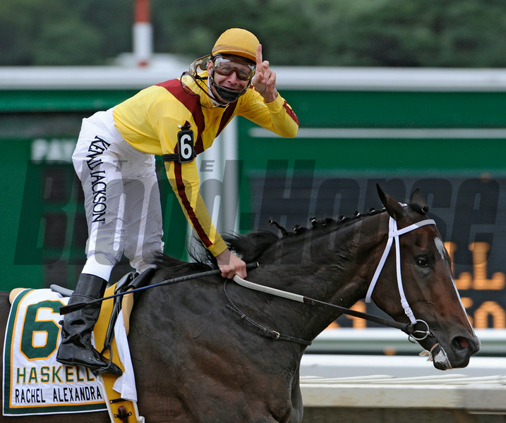 Jockey Calvin Borel aboard Rachel Alexandra shows the #1 sign as he heads to the win in the 42nd running of The Haskel Invitational at Monmouth Park in Oceanport, New Jersey August 2, 2009.