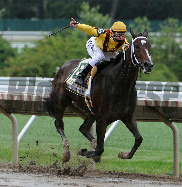 Jockey Calvin Borel aboard Rachel Alexandra shows the #1 sign as he heads to the win in the 42nd running of The Haskell Invitational at Monmouth Park in Oceanport, New Jersey August 2, 2009.