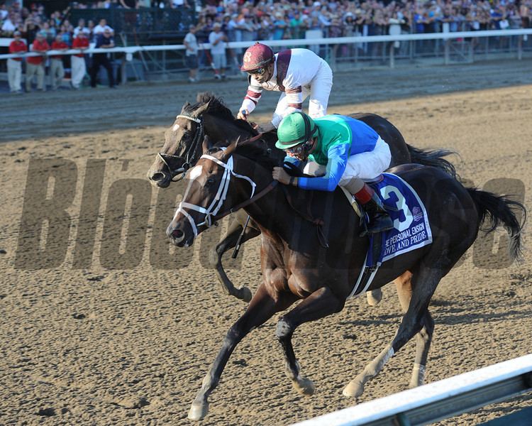 Love and Pride with jockey John Velazquez stuns the field to win the Personal Ensign Stakes with a late charging but beaten favorite Royal Delta with jockey Mike Smith coming up her shoulder at the Saratoga Race Course  in Saratoga Springs, N.Y. Aug. 25, 2012.
