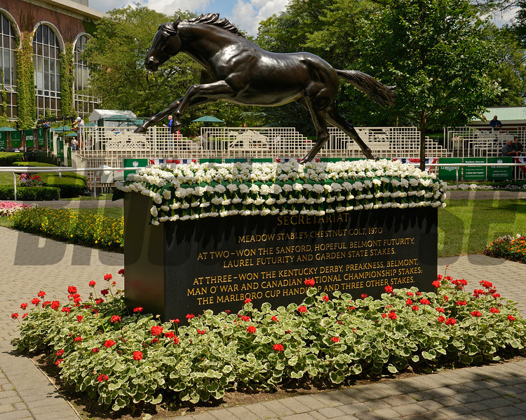Caption:  Secretariat statue with blanket of carnations in Belmont paddock<br /> Belmont Park, June 7, 2012, Elmont, N.Y.<br /> Training hours activity on the track and at the barn.<br /> Photo by Anne M. Eberhardt