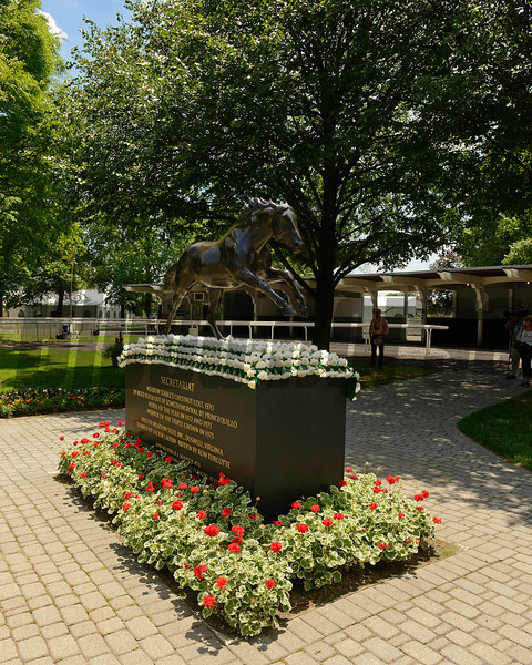 Caption:  Secretariat statue with blanket of carnations in paddock<br /> Belmont Park, June 7, 2012, Elmont, N.Y.<br /> Training hours activity on the track and at the barn.<br /> Photo by Anne M. Eberhardt