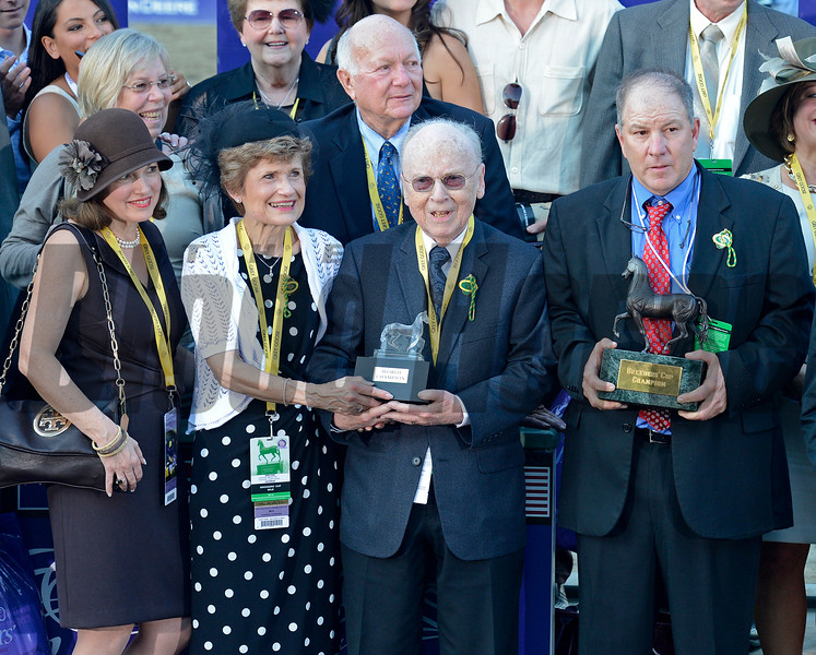Caption: l-r-, Bonnie Fink Marcus (daughter), Mr. and Mrs. Morton (Elaine) Fink, and trainer Charlie Lopresti.  Wise Dan with John Velazquez wins the Mile.<br /> Breeders' Cup races at Santa Anita near Arcadia, California, on Nov. 3, 2012.<br /> BCRACES2012       Mile  image577<br /> Photo by Anne M. Eberhardt