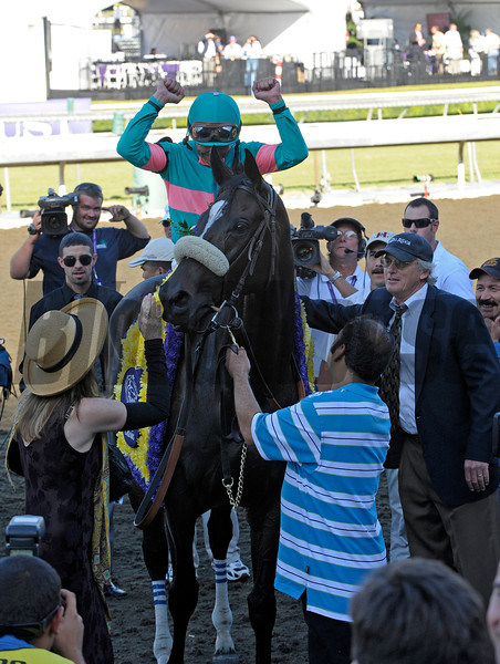 Caption: Mike Smith reacts as Zenyatta stops to pose. Owner Ann Moss pets her with trainer John Shirreffs on right.<br /> Zenyatta with Mike Smith wins the Breeders' Cup Ladies Classic (gr. I)  on October 24, 2008, at Santa Anita in Arcadia, California.<br /> Race7LadiesClassic  image564<br /> Poto by Anne M. Eberhardt