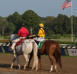Curlin rides to the post, accompanied by his pony, Pancho