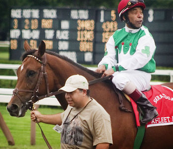 Afleet Alex, being honored after the second race, parades at Saratoga on 9/3/05, Angel Cordero, Jr., up.
