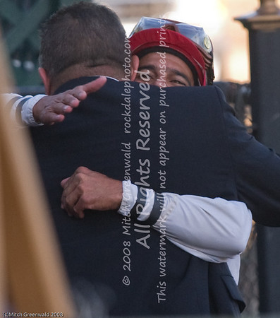 A hug . . Pedro Rodriguez and trainer/part-owner Michael Lecesse CRW_4701